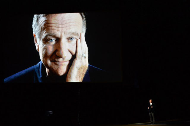 Actor Billy Crystal (R) speaks in tribute to the late Robin Williams onstage at the 66th Annual Primetime Emmy Awards held at Nokia Theatre L.A. Live on August 25, 2014 in Los Angeles, California.     Kevin Winter/Getty Images/AFP