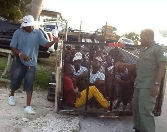 Haitianos en jaula