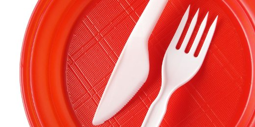 red disposable plate with fork and knife